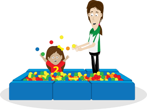 Child and therapist playing in a ball pit