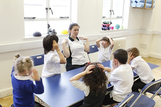 Children playing Simon Says with Therapist